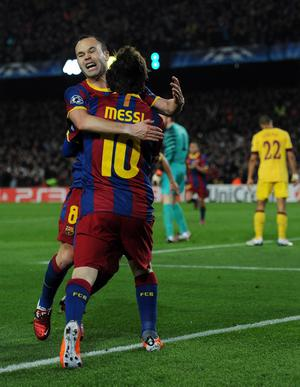 BARCELONA, SPAIN - MARCH 08:  Lionel Messi (R) of Barcelona celebrates scoring his sides opening goal with his teammate Andres Iniesta during the UEFA Champions League round of 16 second leg match between Barcelona and Arsenal on March 8, 2011 in Barcelona, Spain.  (Photo by Jasper Juinen/Getty Images)