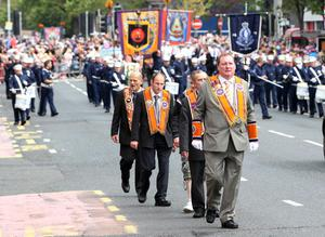 12/7/11 Mandatory Credit Darren Kidd/Presseye.com Orangemen take part in Twelfth of July parades as they make their way to the field at Shaws Bridge, Belfast.The parade makes its way along the Lisburn Rd,   LOL1189