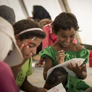 Children take part in drawing activities in one of Save The Children's Child Friendly Spaces in Za'atari Refugee Camp, Jordan
