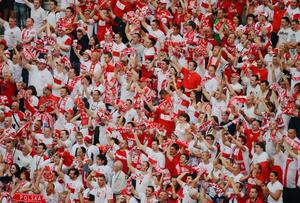 WARSAW, POLAND - JUNE 08:  Polish fans soak up the atmopshere during the UEFA EURO 2012 Group A match between Poland and Greece at National Stadium on June 8, 2012 in Warsaw, Poland.  (Photo by Shaun Botterill/Getty Images)