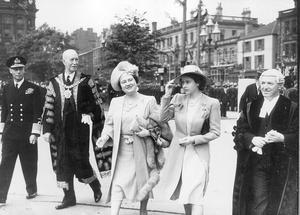 The Queen, Elizabeth 11. Princess Elizabeth 1945 Visit.The Royal visit to belfast, the Royal party consisting of Princess Elizabeth and the Queen mother, are escorted to the City Hall by the Lord Mayor and the Town Clerk, Mr John Dunlop.  18/7/1945