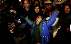 Marcelo Vilquinina, nephew of trapped miner Carlos Mamani Solis, yawns as he watches rescue operations on TV from the camp outside the San Jose mine near Copiapo, Chile, Wednesday Oct. 13, 2010. Thirty-three miners became trapped when the gold and copper mine collapsed on Aug. 5. Mamani was the fourth miner to be rescued. (AP Photo/Natacha Pisarenko)