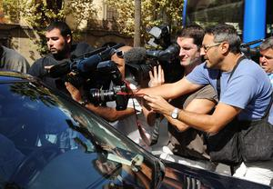 Photographers and cameramen surround the car of Andy Cowles, the partner of the late Stephen Gately, leaving the courthouse in Palma de Mallorca, Spain after attending the inquest inquiry