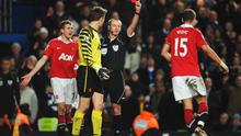 LONDON, ENGLAND - MARCH 01: Nemanja Vidic of Manchester United is shown the red card by referee Martin Atkinson during the Barclays Premier League match between Chelsea and Manchester United at Stamford Bridge on March 1, 2011 in London, England.  (Photo by Clive Mason/Getty Images)