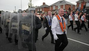 The scene at the Ardoyne interface in north Belfast as an Orange Order parade passes through the flashpoint area