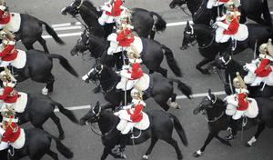 Members of the Household Cavalry mounted regiment travel along the Processional Route to Buckingham Palace, in London. PRESS ASSOCIATION Photo. Picture date: Friday April 29, 2011. See PA story WEDDING Lead. Photo credit should read: Damien Meyer/PA Wire