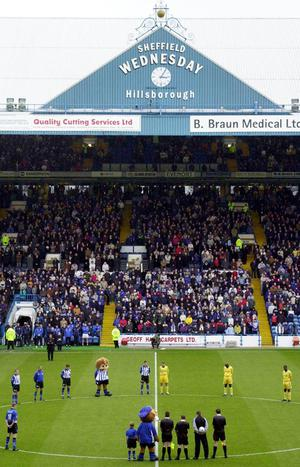 Fans and players observe a minutes silence at Hillsborough