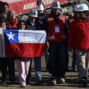 Relatives of the trapped miners await further news of their rescue in Chile (AP)