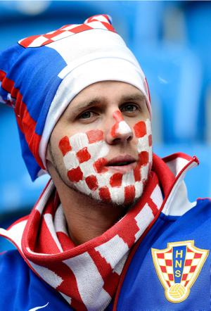 POZNAN, POLAND - JUNE 14:  A Croatia fan looks on during the UEFA EURO 2012 group C match between Italy and Croatia at The Municipal Stadium on June 14, 2012 in Poznan, Poland.  (Photo by Claudio Villa/Getty Images)