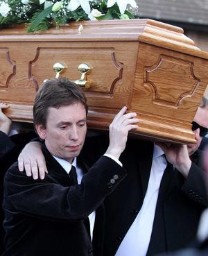 Snooker player and friend Ken Doherty  helping to carry the coffin.