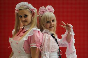 LONDON, ENGLAND - OCTOBER 26:  Ida Therese Hovik, 15, and Karoline Jorgensen, 16, from Norway poses as Maids  ahead of the MCM London Comic Con Expo at ExCel on October 26, 2012 in London, England. Visitors to the Comic Convention are encouraged to wear a costume of their favourite comic character and flock to the Expo to gather all the latest news in the world of comics, manga, anime, film, cosplay, games and cult fiction.  (Photo by Dan Kitwood/Getty Images)