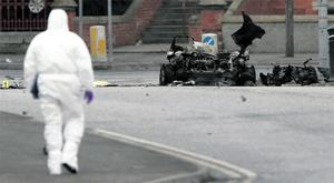 The scene of destruction at Newry courthouse yesterday where clearing up began after a 250lb car bomb exploded on Monday night