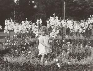 Princess Elizabeth of York with lilies in 1929
