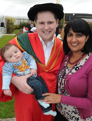 Dr. Barry Kerr who graduated from the University of Ulster at Coleraine on monday with his 16 weeks old son Aadi and his wife Shal. PIcture Martin McKeown. Inpresspics.com. 27.6.11