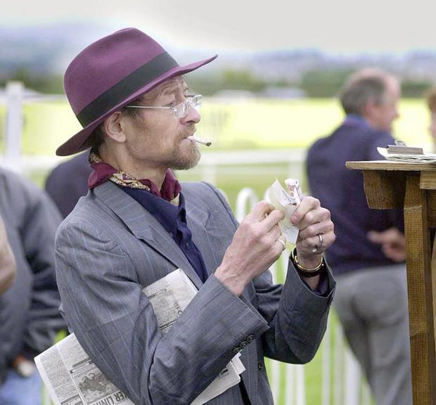 Former World Champion snooker star Alex Higgins enjoys a day out at the races despite fighting off the effects of throat cancer.