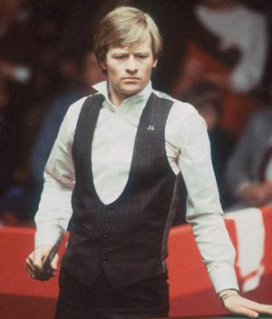 Alex Higgins considering his next shot during the 1983  World Snooker Championships in Sheffield.