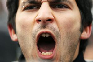 NEW YORK, NY - JANUARY 29:  A man yells during a protest against the regime of Egyptian President Hosni Mubarak outside of the United Nations on January 29, 2011 in New York City.  Egypt, a Muslim nation that has a long and deep-seated relationship with America is the latest Muslim country after Tunisia to be shaken by waves of violent protests demanding that the current regime step down.  (Photo by Spencer Platt/Getty Images)
