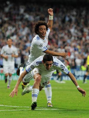 MADRID, SPAIN - APRIL 05:  Angel Di Maria (R) of Real Madrid celebrates scoring with his teammate Marcelo during the UEFA Champions League quarter final first leg match between Real Madrid and Tottenham Hotspur at Estadio Santiago Bernabeu on April 5, 2011 in Madrid, Spain.  (Photo by Jasper Juinen/Getty Images)