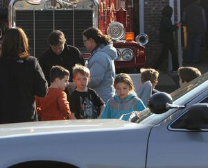 School children wait for their parents at the Sandy Hook firehouse following a mass shooting at the Sandy Hook Elementary School  Friday, Dec. 14, 2012 in Newtown, Conn. A man opened fire inside the Connecticut elementary school where his mother worked Friday, killing 26 people, including 18 children, and forcing students to cower in classrooms and then flee with the help of teachers and police. (AP Photo/The Journal News, Frank Becerra Jr.) MANDATORY CREDIT, NYC OUT, NO SALES, TV OUT, NEWSDAY OUT; MAGS OUT