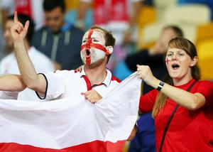 KIEV, UKRAINE - JUNE 15:  England fans celebrate during the UEFA EURO 2012 group D match between Sweden and England at The Olympic Stadium on June 15, 2012 in Kiev, Ukraine.  (Photo by Alex Livesey/Getty Images)
