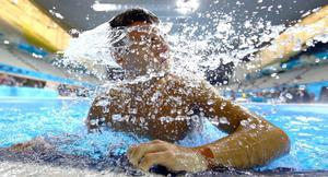 Diver Tom Daley of Great Britain shakes water out of his hair as he climbs out of the pool during a diving training session ahead of the London Olympic Games at the Aquatics Centre in Olympic Park on July 26, 2012 in London, England.  (Photo by Al Bello/Getty Images)