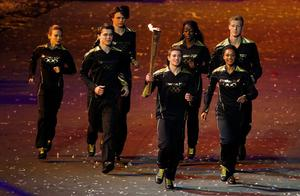 The Olympic torch is carried by seven young athletes during the London Olympic Games 2012 Opening Ceremony at the Olympic Stadium, London. PRESS ASSOCIATION Photo. Picture date: Saturday July 28, 2012. See PA story OLYMPICS Ceremony. Photo credit should read: Dave Thompson/PA Wire. EDITORIAL USE ONLY