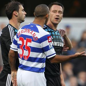 Chelsea footballer John Terry (right) was cleared in court of racially abusing QPR player Anton Ferdinand