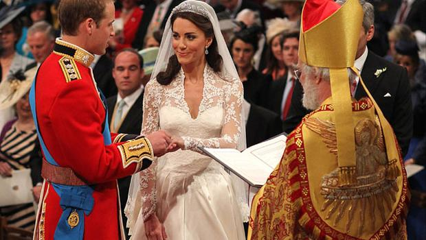 LONDON, ENGLAND - APRIL 29:  Prince William exchanges rings with his bride Catherine Middleton in front of the Archbishop of Canterbury Rowan Williams inside Westminster Abbey on April 29, 2011 in London, England.  The marriage of Prince William, the second in line to the British throne, to Catherine Middleton is being held in London today. The marriage of the second in line to the British throne is to be led by the Archbishop of Canterbury and will be attended by 1900 guests, including foreign Royal family members and heads of state. Thousands of well-wishers from around the world have also flocked to London to witness the spectacle and pageantry of the Royal Wedding.  (Photo by Dominic Lipinski - WPA Pool/Getty Images)