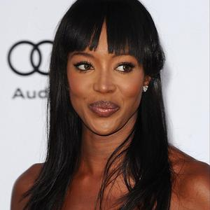 Naomi Campbell told the war crime trial that she handed diamonds to a Mandela charity official