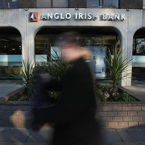Officials are working to wind down nationalised lender Anglo Irish Bank by the end of January 2011, the governor of the central bank has said