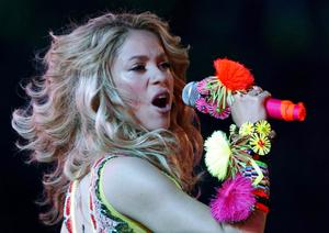 Colombian pop star Shakira, center stage, performs during the closing ceremony ahead of the World Cup final soccer match between the Netherlands and Spain at Soccer City in Johannesburg, South Africa