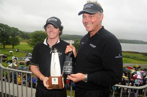 Darren Clarke and Rory McIlroy after winning at the Lough Erne Golf Challenge