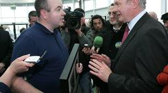 Presidential candidate Martin McGuinness is confronted by David Kelly in Athlone