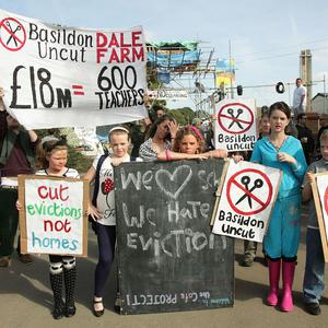 Supporters of Dale Farm residents have called for the council pressing for their eviction to 'return to the negotiating table'