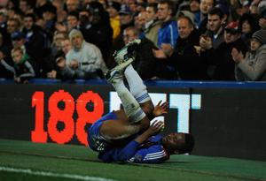 LONDON, ENGLAND - NOVEMBER 14:  John Obi Mikel of Chelsea takes a tumble during the Barclays Premier League match between Chelsea and Sunderland at Stamford Bridge on November 14, 2010 in London, England.  (Photo by Michael Regan/Getty Images)