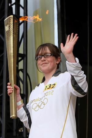 Louise Lyons lighting the cauldron after the Torch Relay leg between Dervock and Portrush