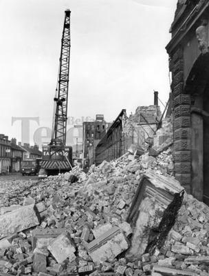 Riots : Belfast. August 1969.  Piles of rubble litter the Falls Road, Belfast.  In the background is a crane being used for demolition work.  (19/8/69)