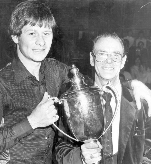 Alex Higgins.  Snooker Legend.  Alex Higgins senior pictured with his son after Alex had regained the Smithwick's Irish Professional Snooker Championship in Maysfield Leisure Centre.  Alex won the final against reigning champion Dennis Taylor by 16 frames to 11.