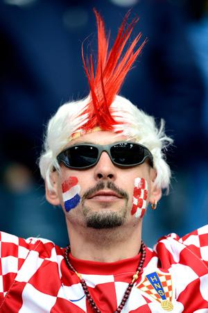 POZNAN, POLAND - JUNE 14:  A Croatian fan enjoys the pre-match atmopshere during the UEFA EURO 2012 group C match between Italy and Croatia at The Municipal Stadium on June 14, 2012 in Poznan, Poland.  (Photo by Claudio Villa/Getty Images)