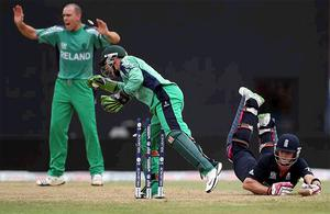 Craig Kieswetter of England is run out by Ireland's Niall O'Brien during the ICC T20 World Cup match at the Guyana National Stadium
