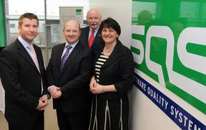 Enterprise Minister Arlene Foster is joined by (l-r) Rob McConnell, SQS Marketing Director NI, Phil Codd, Managing Director of SQS Ireland and Rudolf van Megen, SQS CEO, at the jobs announcement
