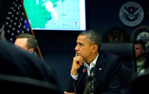 WASHINGTON, DC - OCTOBER 28:  (AFP-OUT) U.S. President Barack Obama listens to a briefing on Hurricane Sandy at FEMA Headquarters on October 28, 2012 in Washington, D.C. Sandy, which has already claimed over 50 lives in the Caribbean, is predicted to bring heavy winds and floodwaters as the mid-atlantic region prepares for the damage.  (Photo by Dennis Brack-Pool/Getty Images)