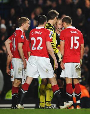 LONDON, ENGLAND - MARCH 01:  Nemanja Vidic of Manchester United goes head to head with referee Martin Atkinson after being shown the red card during the Barclays Premier League match between Chelsea and Manchester United at Stamford Bridge on March 1, 2011 in London, England.  (Photo by Clive Mason/Getty Images)
