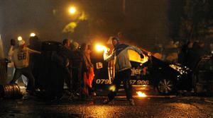 Police clash with protesters in the Ardoyne Road area of north Belfast