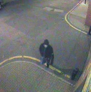 CCTV footage of the gunman moments after German Gorbuntsov was shot as he entered his block of flats (Met Police/PA)