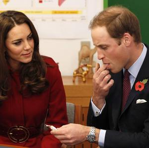 The Duchess of Cambridge watches as her husband tries a high energy paste