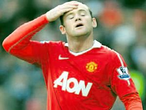 Feeling the heat: Wayne Rooney cuts a frustrated figure as Manchester United dropped more points on Saturday