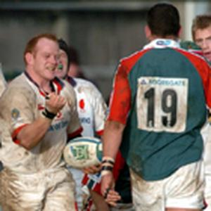 Robbie Kempson can't resist the temptation to celebrate in front of then England captain and Leicester legend Martin Johnson during an Ulster win at Ravenhill.