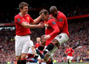 MANCHESTER, ENGLAND - APRIL 15:  Wayne Rooney of Manchester United celebrates scoring the opening goal with team mates Michael Carrick (L) and Ashley Young (R) during the Barclays Premier League match between Manchester United and Aston Villa at Old Trafford on April 15, 2012 in Manchester, England.  (Photo by Alex Livesey/Getty Images)