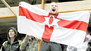 A flagwaving loyalist on scaffolding in the city centre